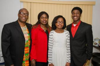 Kwasi Enin (r.) poses for a photo with his dad Ebenezer (l.), his mom Doreen (2nd from l.), and his sister Adwoa (2nd from r.). Photo Credit: David Wexler